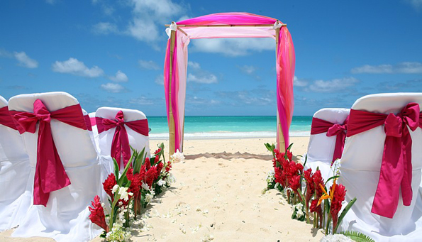 fuscia-red-chair-cover-sashes-plus-hawaiian-flowers